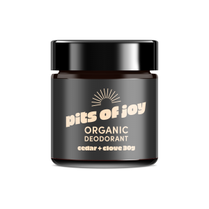 A 30g jar of Pits of Joy organic deodorant paste, in Cedar and Clove
